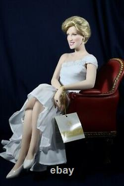 Franklin mint princess diana porcelain doll sitting in red chair
