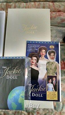 Jackie Kennedy porcelain doll with trunk, 13 outfits plus book of authenticity